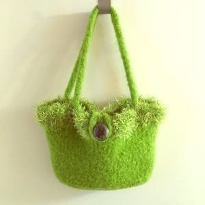 Green shaggy purse with button